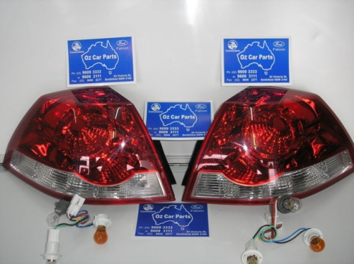 HOLDEN COMMODORE VE TAIL LIGHTS BRAND NEW pair GENUINE HOLDEN